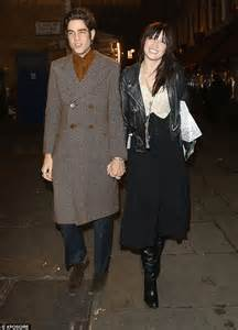 Thomas Cohen holds hands with mystery brunette at London